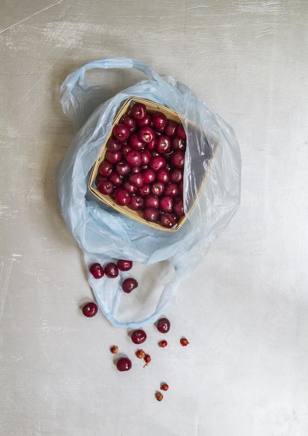Tart cherries on worn silver background